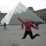 Jumping in front of the Louvre Pyramid