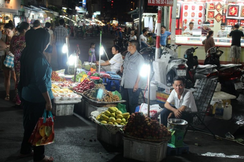 "Vendors selling goods in the streets during ""Night Market"" near Ben Thanh Market"