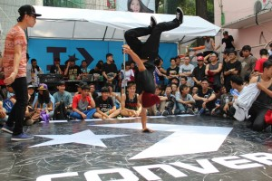 A HipHop (B-boy) dancer landing a freeze during the Converse Street Festival