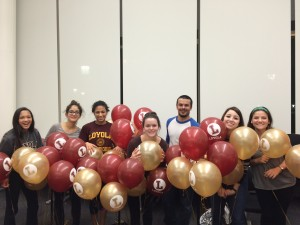 Student Workers pose with balloons while prepping for Loyola's October Open House.